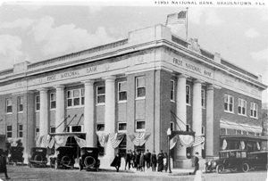 First national bank with cars.